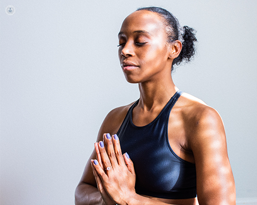 A woman performing mindfulness